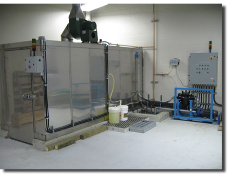Pioneer Industries cubicle style sanitizing cart wash system.